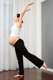 Pregnant woman doing exercise at home Royalty Free Stock Photos