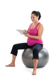 Pregnant woman doing exercise research Stock Photo