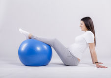 Pregnant woman doing exercise Royalty Free Stock Images