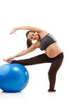 Pregnant woman doing exercises Stock Photography