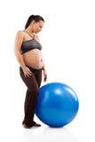 Pregnant woman doing exercises Stock Photo