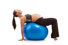 Pregnant woman doing exercises Royalty Free Stock Images