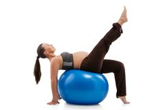 Pregnant woman doing exercises Stock Images