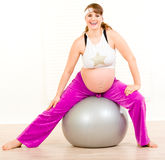 Pregnant woman doing exercises on fitness ball Stock Photography