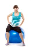 Pregnant woman is doing exercises Stock Photo