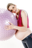 Pregnant woman doing exercises Stock Photos
