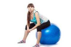 Pregnant woman is doing exercises Royalty Free Stock Photography