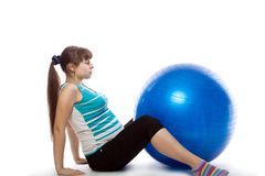Pregnant woman is doing exercises Royalty Free Stock Photo
