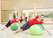 Pregnant woman doing fitness ball exercise Royalty Free Stock Images