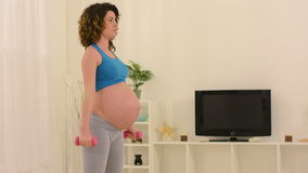 Pregnant Woman Doing Fitness stock video footage