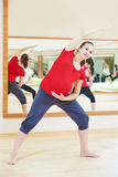 Pregnant woman doing fitness exercise Royalty Free Stock Image