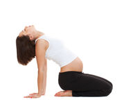 Pregnant woman doing gymnastic Royalty Free Stock Photography