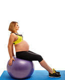 Pregnant woman doing gymnastic exercises Stock Photos