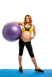 Pregnant woman doing gymnastic exercises Royalty Free Stock Photography