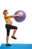 Pregnant woman doing gymnastic exercises Stock Photo