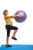 Pregnant woman doing gymnastic exercises Stock Photo