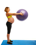 Pregnant woman doing gymnastic exercises Royalty Free Stock Images