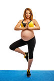 Pregnant woman doing gymnastic exercises Stock Photos
