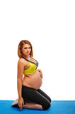 Pregnant woman doing gymnastic exercises Royalty Free Stock Image