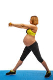 Pregnant woman doing gymnastic exercises Stock Images