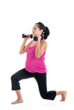 Pregnant woman doing lunge with dumbbells Royalty Free Stock Photography