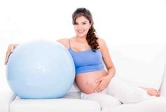 Pregnant woman doing Pilates Stock Photo