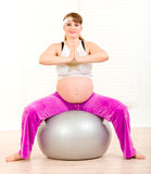Pregnant woman doing pilates exercises on ball Stock Photos