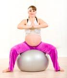 Pregnant woman doing pilates exercises on ball Stock Photos