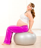 Pregnant woman doing pilates exercises on ball Stock Images