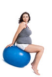 Pregnant woman doing pilates exercises Stock Images