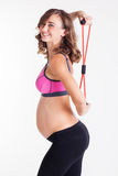 Pregnant woman doing pilates with rubber band Royalty Free Stock Photo