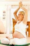 Pregnant woman doing pregnancy yoga Royalty Free Stock Images