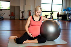 Pregnant woman doing relaxation exercise Royalty Free Stock Photos
