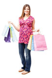 Pregnant woman doing some shopping. Full length portrait of a beautiful young pregnant Hispanic woman shopping some clothes for her and her baby royalty free stock photos
