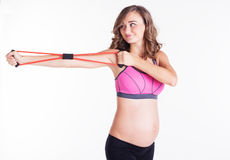 Pregnant woman doing sport with resistance bands Stock Photo