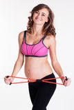 Pregnant woman doing sports exercises Stock Photography