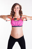Pregnant woman doing stratching exercise Royalty Free Stock Photography