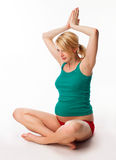 Pregnant woman doing stretching exercise stock photo