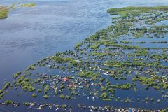 Flooded terrain in lowlend of Great river. Ob River Flood June 2015 Aerial View of same houses in vicinity of Nizhnevartovsk, Tyumen region, Russia. Aerial view royalty free stock images