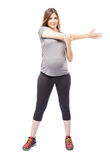Pregnant woman doing stretching exercises Royalty Free Stock Photo
