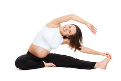 Pregnant woman doing stretching gymnastic. Healthy pregnant woman doing stretching gymnastic over white background Stock Image
