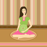 Pregnant woman doing yoga Royalty Free Stock Photo