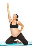Pregnant woman doing yoga Stock Photos