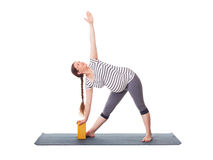 Pregnant woman doing yoga asana Utthita trikonasana Stock Images