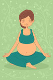 Pregnant woman doing yoga exercise Stock Photos