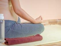 Pregnant woman doing yoga. Healthy motherhood concept Stock Photography