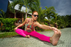 Pregnant woman doing yoga. Healthy pregnant woman doing yoga in nature outdoors Stock Photography