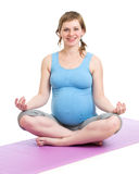 Pregnant woman doing yoga in studio Royalty Free Stock Photo
