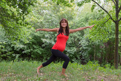 A pregnant woman doing yoga. In the park Royalty Free Stock Images