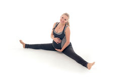 Pregnant woman doing yoga Royalty Free Stock Images